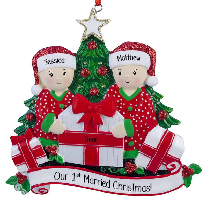 First Married Couple Opening Presents By Tree Ornament